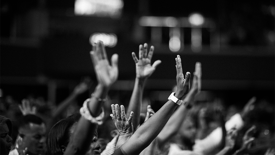photography-of-people-raising-hands